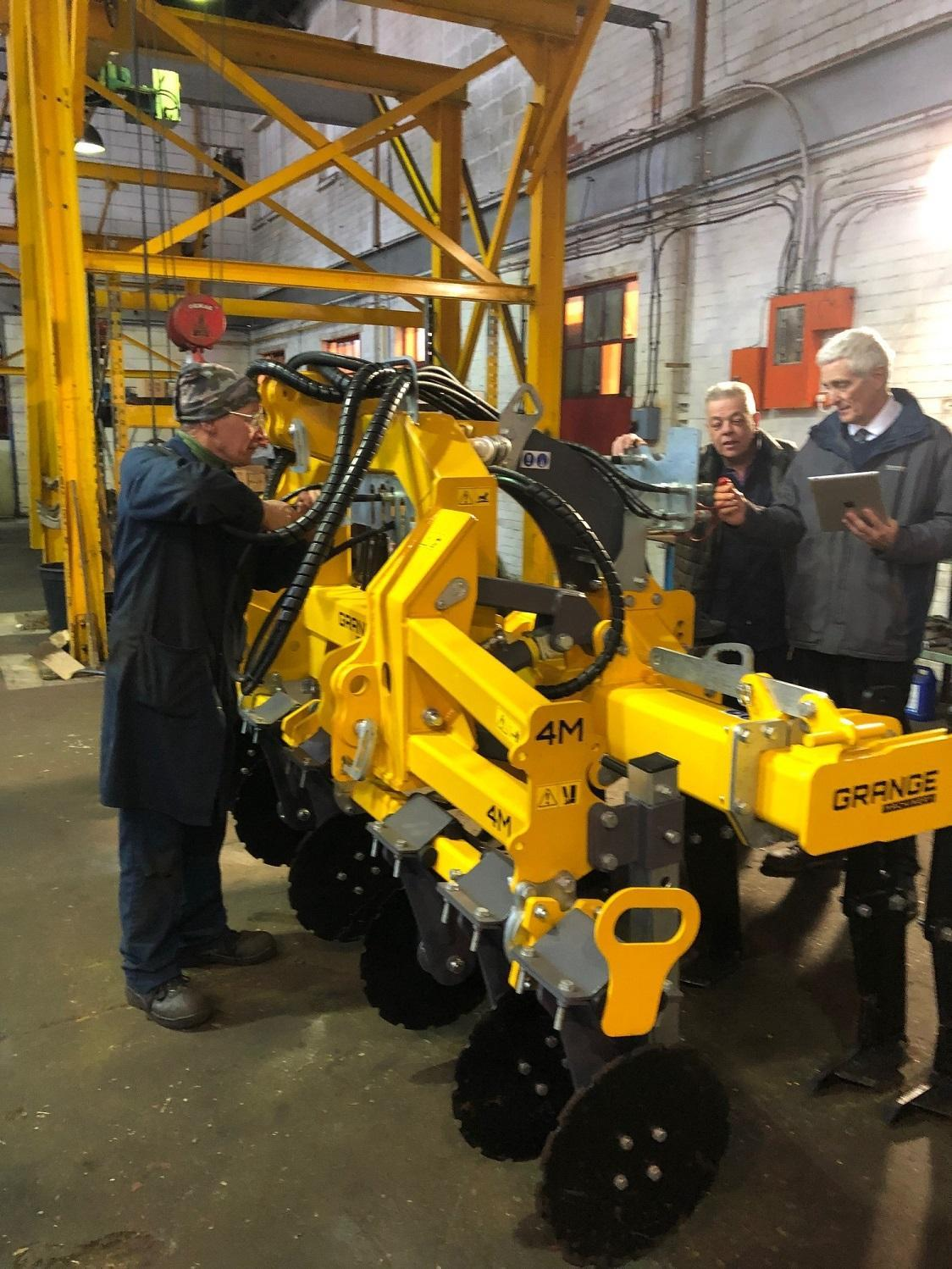Polydon Industries engineers at work on yellow machinery